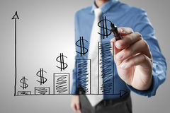 Businessman drawing graphics  growing graph Royalty Free Stock Image