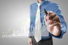 Businessman drawing graphics  growing graph Stock Images