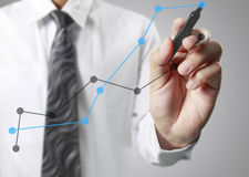 Businessman drawing graphics growing graph Stock Photo