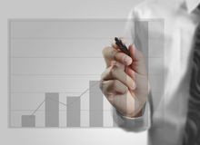 Businessman drawing graphics growing graph Stock Image