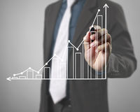 Businessman drawing graphics  growing graph Royalty Free Stock Photos