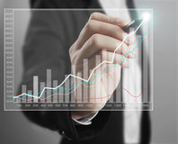 Businessman drawing graphics growing graph Stock Photography