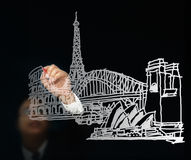 Businessman drawing great buildings architecture Royalty Free Stock Images