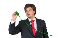 Businessman drawing green arrow Stock Photo