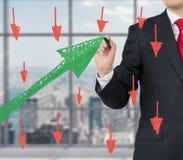 Businessman drawing green graph Royalty Free Stock Photo