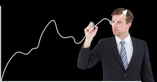 Businessman drawing growth graph against black background Stock Images