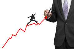 Businessman drawing growth red arrow and another jumping on it, Royalty Free Stock Photo