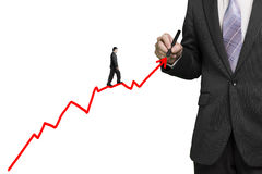 Businessman drawing growth red arrow and another walk on it Royalty Free Stock Image