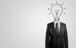 Businessman drawing a head lamp Stock Photography