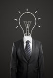 Businessman drawing a head lamp Royalty Free Stock Photos