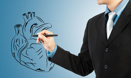Businessman drawing heart diagram Royalty Free Stock Photos