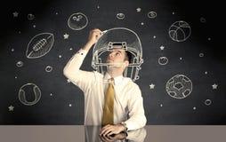 Businessman drawing helmet and sport balls Royalty Free Stock Photos
