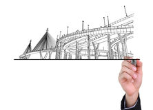 Businessman drawing highways. Royalty Free Stock Photos