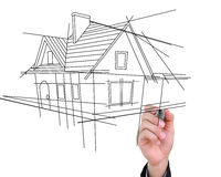 Businessman drawing house. Stock Photos