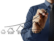 Businessman drawing house Stock Photos