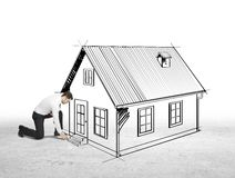 Businessman drawing house Royalty Free Stock Photo