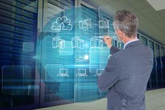 Businessman drawing icons from the back against database background. Digital composite of model drawing in server room Royalty Free Stock Image