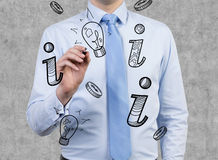 Businessman drawing icons Royalty Free Stock Photos
