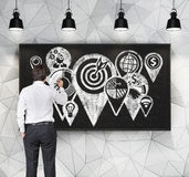 Businessman drawing icons Stock Photography