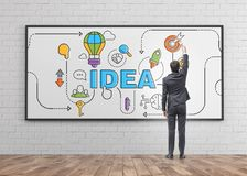 Businessman drawing idea sketch on whiteboard Royalty Free Stock Photography