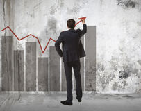 Businessman drawing increasing graph Royalty Free Stock Images