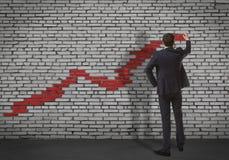 Businessman drawing increasing graph Royalty Free Stock Photos