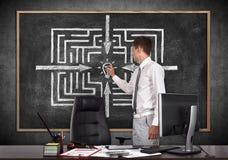Businessman drawing labyrinth Royalty Free Stock Photo