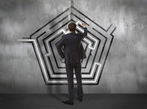 Businessman drawing labyrinth on wall Royalty Free Stock Photo