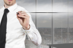 Businessman drawing line in the air office. Businessman in black suit drawing line in the air underline Royalty Free Stock Image
