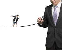 Businessman drawing line with another balancing on it Stock Images