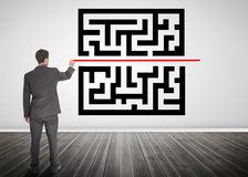 Businessman drawing a line through qr code Stock Image