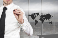 Businessman drawing line and worldmap in the air Royalty Free Stock Image