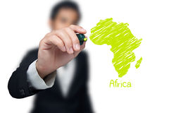 Businessman drawing a map. Businessman drawing a map of continent Africa Royalty Free Stock Photos