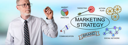 Businessman drawing marketing strategy concept Stock Photography