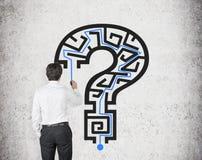 Businessman drawing  maze Stock Image