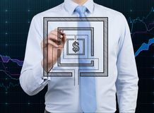 Businessman drawing maze Royalty Free Stock Photo