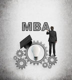 Businessman drawing mba Royalty Free Stock Images