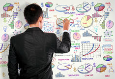 Businessman drawing modern business concept on white Royalty Free Stock Photography