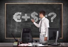 Businessman drawing money formula Royalty Free Stock Photo