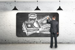 Businessman drawing money sketch Royalty Free Stock Photos