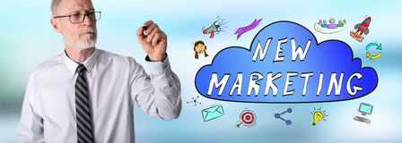 Businessman drawing new marketing concept. New marketing concept drawn by a businessman stock image