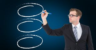Businessman drawing  outline against blue background Royalty Free Stock Photos