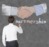 Businessman drawing partnership symbol Stock Images