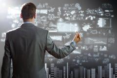 Businessman drawing plan Royalty Free Stock Photos