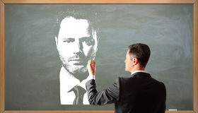 Businessman drawing portrait Royalty Free Stock Photography