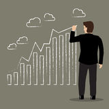 Businessman drawing positive trend graph Royalty Free Stock Images