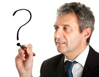 Businessman drawing a question mark Royalty Free Stock Image