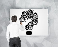 Businessman drawing question mark. Icon on poster Royalty Free Stock Photos