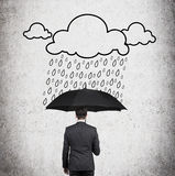 Businessman and drawing rain Stock Photo