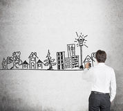Businessman drawing real estate Royalty Free Stock Photography